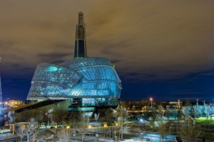 Image of the Canadian Museum of Human Rights lit up at night
